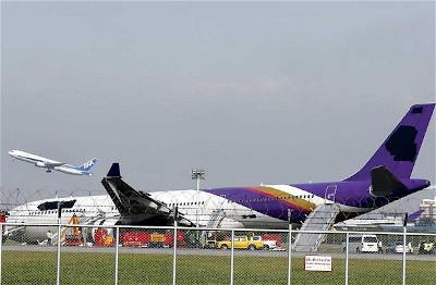 Thai Airways plane with blacked out logo